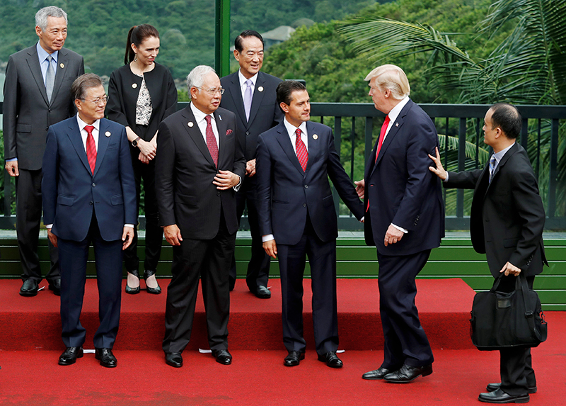 US President Donald Trump (2nd R) joins other leaders during the family photo session at the APEC Summit in Danang, Vietnam November 11, 2017. (Bottom L-R) South Korea's President Moon Jae-in, Malaysia's Prime Minister Najib Razak, Mexico's President Enrique Pena Nieto, (top L-R) Singapore's Prime Minister Lee Hsien Loong, New Zealand's Prime Minister Jacinda Ardern. Photo: Reuters