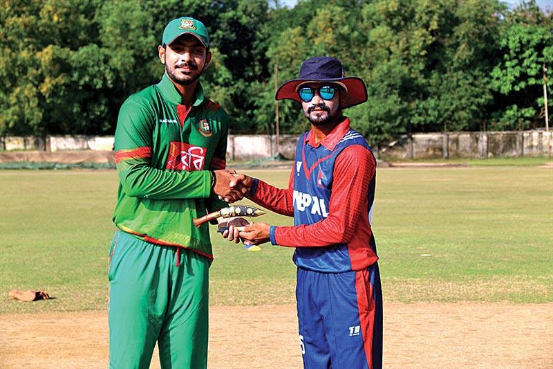 Nepal U-19 cricket team skipper Dipendra Singh Airee exchanging memento with his Bangladeshi counterpart Saif Hasan (left) in Dhaka on Thursday. Photo Courtesy: Raman Shiwakoti