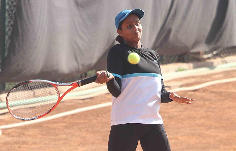 Vaishnavi Adkar returns to fellow Indian player Harsshali Mandevkar during their girls singles match of the Kesha ANLTA Asian U-14 Ranking Championship Circuit-II in Lalitpur on Wednesday, November 8, 2017. Photo: Udipt Singh Chhetry/THT