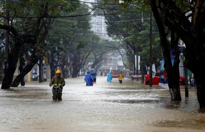 People go along flooded road after typhoon Damrey hits Vietnam in Hue city, Vietnam, on November 5, 2017. Photo: Reuters