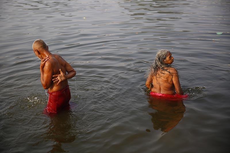 Devotees take bath in a pond offering prayers during the Vivaha Panchami festival at Janaki Temple in Janakpur, on Thursday, November 23, 2017. Photo: Skanda Gautam