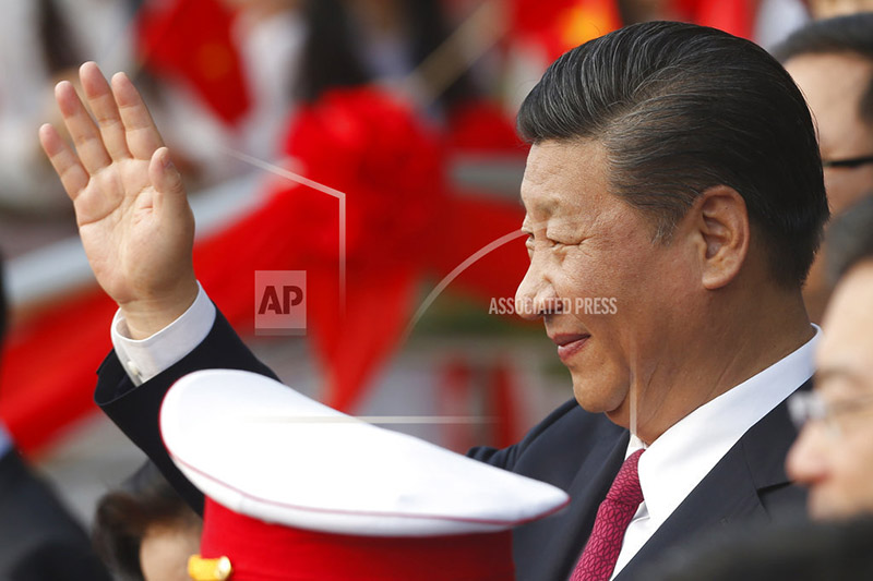 China's President Xi Jinping waves after attending the inauguration ceremony of Chinese sponsored Vietnam-China Cultural Friendship Palace in Hanoi, Vietnam Sunday, Nov. 12, 2017. Photo: AP
