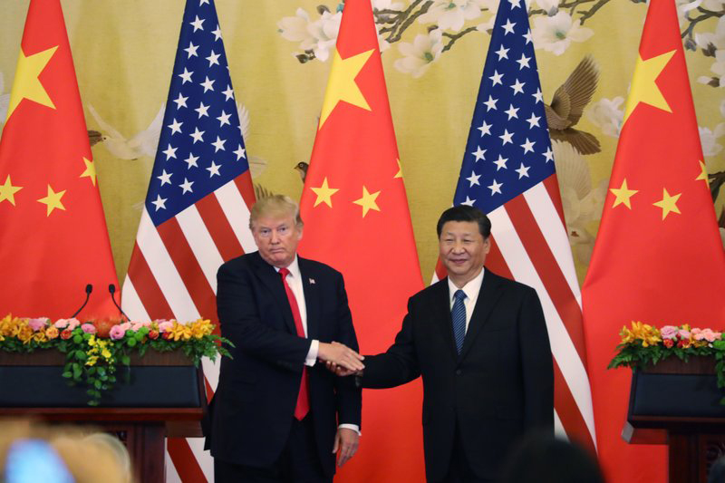 US President Donald Trump, left, and Chinese President Xi Jinping hold their joint press conference at the Great Hall of the People in Beijing, Thursday, November 9, 2017. Photo: AP