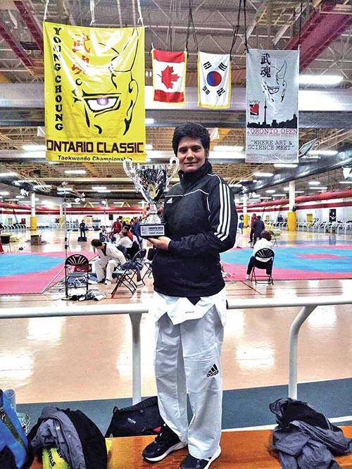 Nepalu2019s Yan Kumari Chaulagain holds the Toronto Open Taekwondo Championship trophy in Canada on Monday.