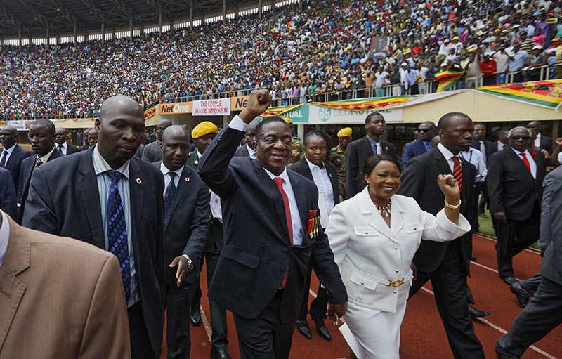 Emmerson Mnangagwa (centre), and his wife Auxillia (centre-right), arrive at the presidential inauguration ceremony in the capital Harare, Zimbabwe, on Friday, November 24, 2017. Photo: AP