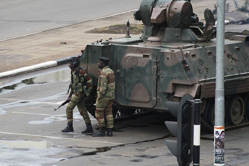 A military tank is seen with armed soldiers on the road leading to President Robert Mugabe's office in Harare, Zimbabwe, on Wednesday, November 15, 2017. Photo: AP