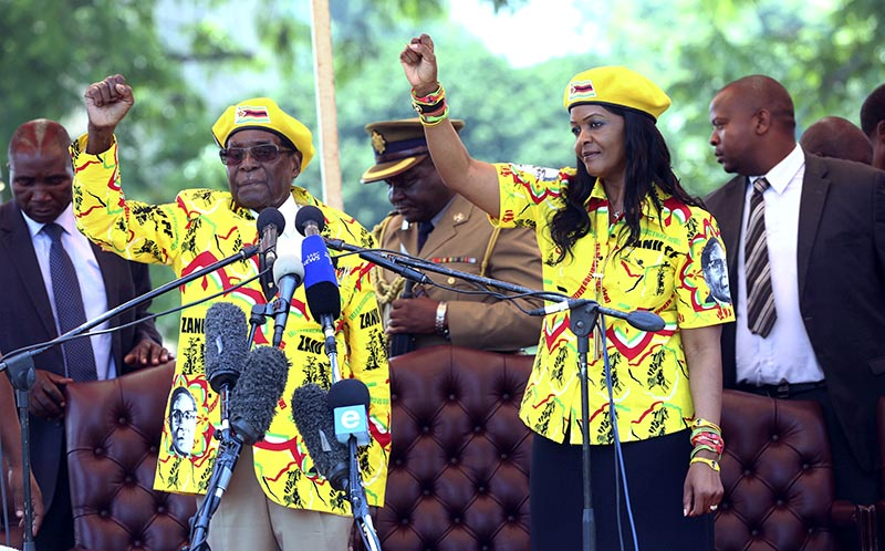 FILE - Zimbabwe's President Robert Mugabe, left, and his wife Grace chant the party's slogan during a solidarity rally in Harare, on Wednesday, November 8, 2017. Photo: AP