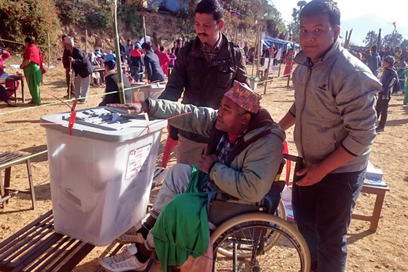 A differently-abled person cast his vote at a polling centre in Jajarkot district, on Sunday, November 26, 2017. Photo: Dinesh Shrestha