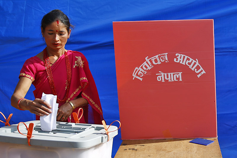 A woman casts her vote during elections at a polling station in Phidim Municipality, Panchthar district, on Sunday, November 26, 2017. Photo: Skanda Gautam