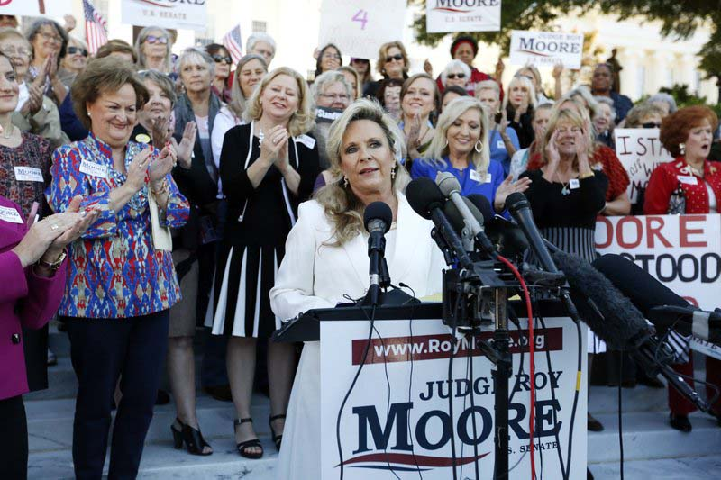 Kayla Moore, wife of former Alabama Chief Justice and US Senate candidate Roy Moore, speaks at a press conference, Friday, November 17, 2017, in Montgomery, Ala. Moore spoke out in defense of her husband, saying they have been married for over 32 years and the Army veteran has always been an officer and a gentleman. Photo: AP