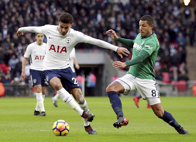 Tottenham Hotspur's Dele Alli (left), and West Bromwich Albion's Jake Livermore in action during their English Premier League soccer match at Wembley Stadium in London, on  Saturday November 25, 2017. Photo: Yui Mok/PA via AP