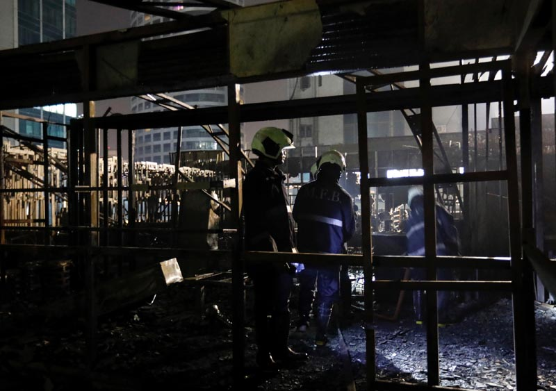 Firemen inspect the debris after a fire at a restaurant in Mumbai, India, on December 29, 2017. Photo: Reuters