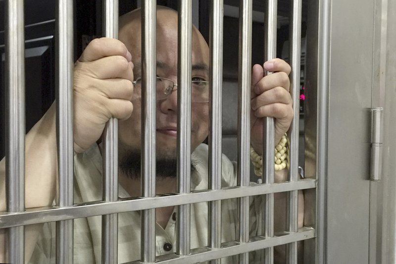 Wu Gan also known as the Ultra Vulgar Butcher is seen behind bars at police station in Nanchang city in eastern Chinau2019s Jiangxi province. A Chinese court on Tuesday, December 26, 2017. Photo: AP