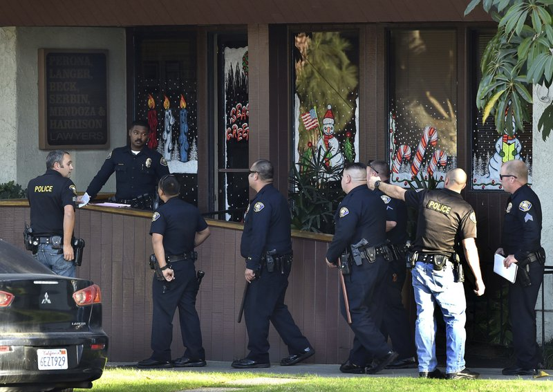 Police officers gather in front of law offices where a deadly shooting took place in Long Beach, Calif., Friday, Dec. 29, 2017. Long Beach police on Friday called the shooting u201cworkplace violence.u201d They said on Twitter that it has become a murder investigation, and that the suspect is also dead at the scene