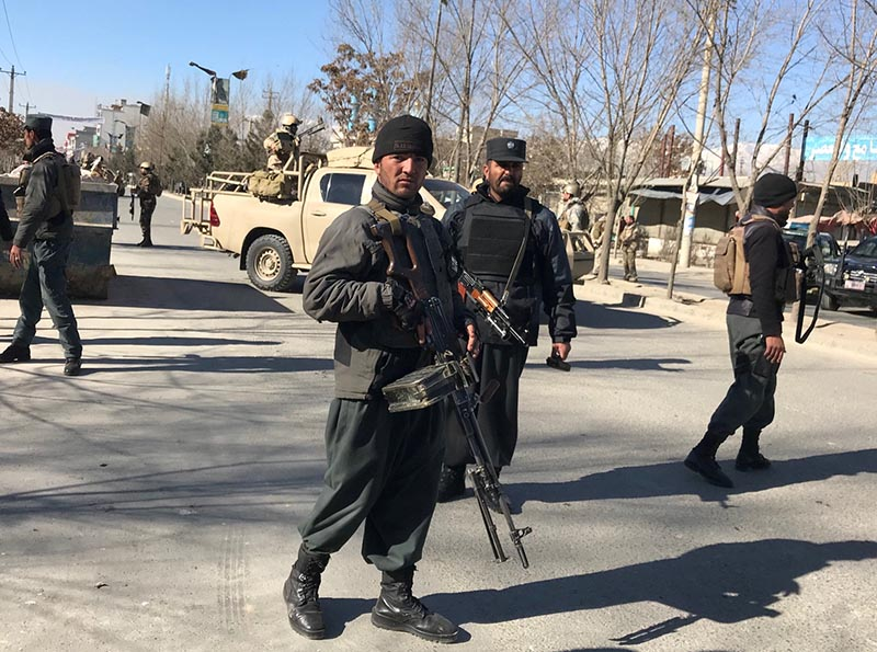 Afghan policemen stand guard at the site of a blast in Kabul, Afghanistan December 28, 2017. Photo: Reuters