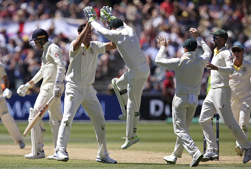 Australia's Mitchell Starc, second left, celebrates with teammates after taking the wicket of England's Craig Overton, left, during the fifth day of their Ashes cricket test match in Adelaide, on Wednesday, December 6, 2017. Photo: AP