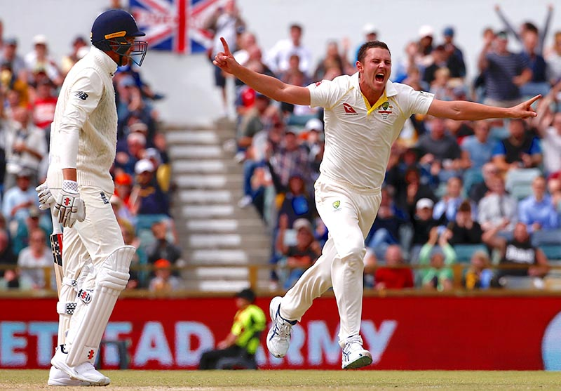 Australia's Josh Hazlewood celebrates after dismissing England's Craig Overton during the fifth day of the third Ashes cricket test match between Australia and England, at WACA Ground, in Perth, Australia, on December 18, 2017. Photo: Reuters