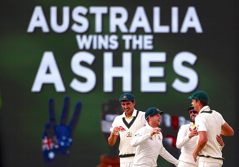 Australia's captain Steve Smith celebrates with team mates after winning the third Ashes cricket test match between Australia and England, at WACA Ground, in Perth, Australia, on December 18, 2017. Photo: Reuters