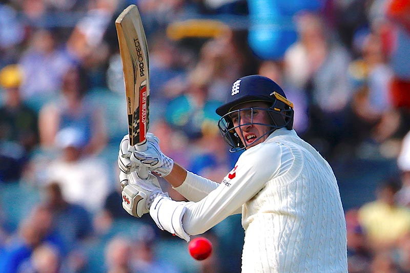 England's Craig Overton hits a boundary during the third day of the second Ashes cricket test match between Australia and England, at Adelaide Oval, in Adelaide, Australia, on December 4, 2017. Photo: Reuters