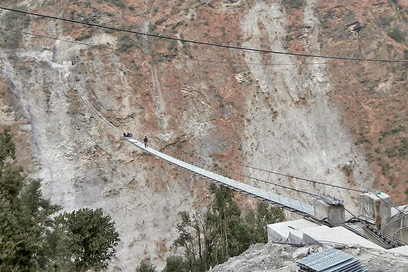 Workers are seen constructing a bailey bridge in Raguganga Rural Municipality-1 in Myagdi district, on Friday, December 22, 2017. Photo: RSS