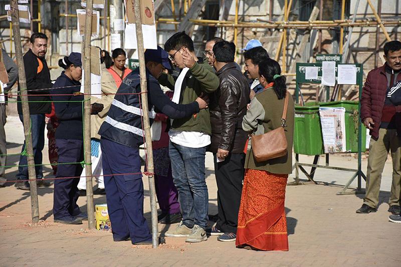 Security personnel frisking voters in Basantapur, Kathmandu, on Thursday, December 7, 2017. Photo: Naresh Shrestha