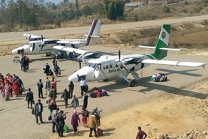 Passengers heading to board Twin Otter aircraft at Bhojpur Airport, in Bhojpur district , on Sunday, December 24, 2017. Photo: Niroj Koirala