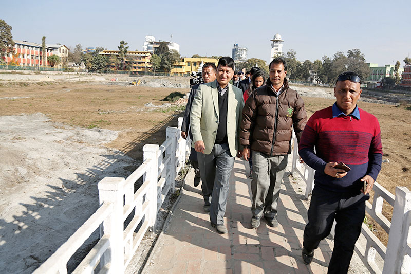 Kathmandu Metropolitan City Mayor Bidya Sundar Shakya along with other officals inspecting reconstruction site of the historical Ranipokhari in Kathmandu, on Tuesday, December 26, 2017. Photo: RSS