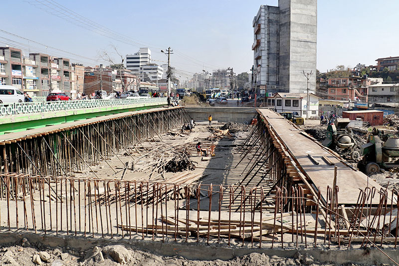 A new bridge is being constructed at Bijuli Bazaar along the Maitighar-Tinkune road section, on Thursday, December 21, 2017. Photo: RSS