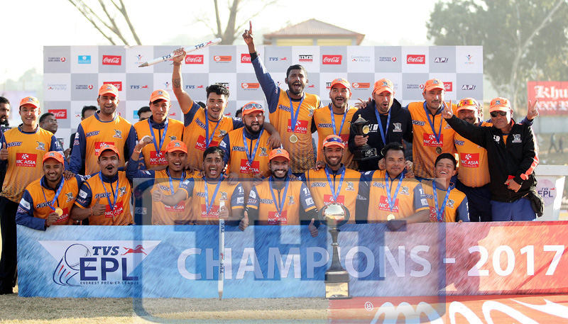 Players and officials of Biratnagar Warriors take group photo with winner's torphy and cash prize during the prize distribution ceremony of the TVS EPL T20 Cricket Tournament at TU Cricket Stadium, Kirtipur in Kathmandu, on Saturday, December 30, 2017. Photo: Udipt Singh Chhetry