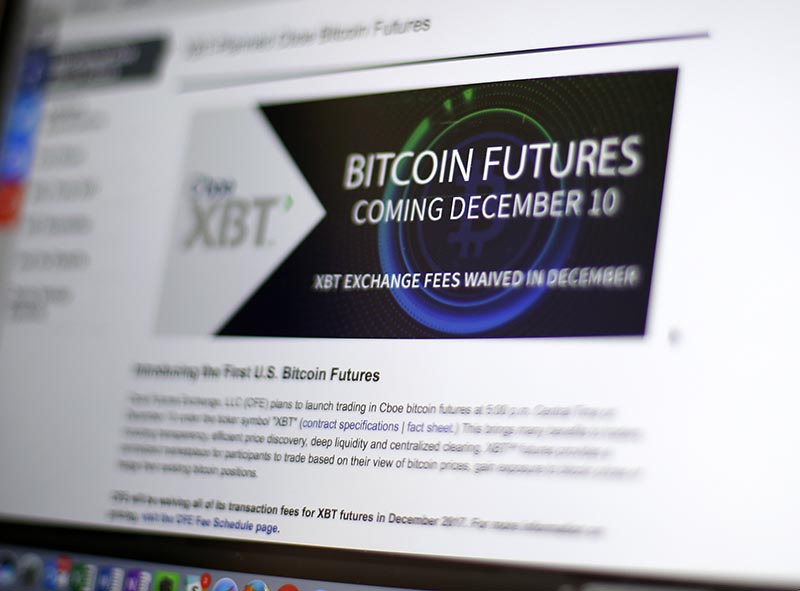 This Friday, December 8, 2017, photo shows the Chicago Board Options Exchange website announcing that bitcoin futures will start trading on the CBOE on Sunday evening, December 10. Bitcoin futures will start trading a week later on the Chicago Mercantile Exchange. Photo: AP