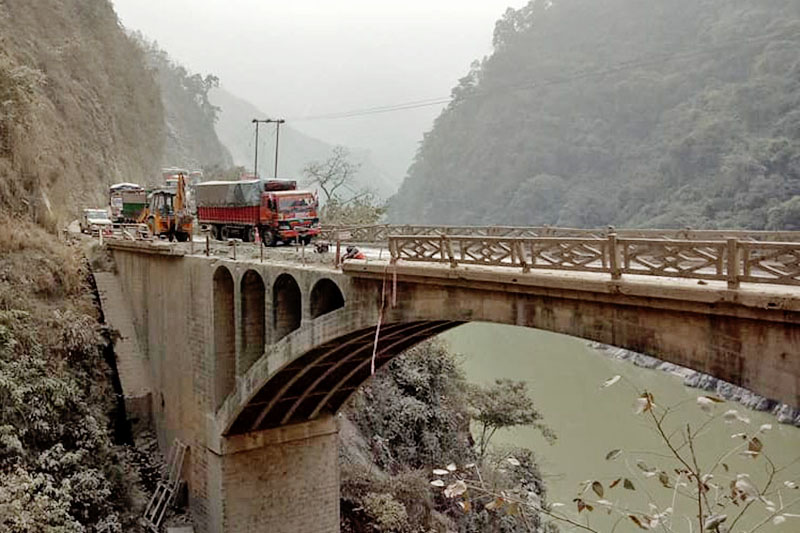 One way traffic Vehicles resumes after a bridge side rallings collapsed along the Narayangard-Muglin road section, on Wednesday, December 20, 2017. Photo: Tilak Ram Rimal
