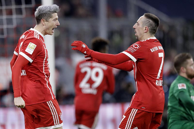 Bayern's Robert Lewandowski (left), celebrates with team mate Franck Ribery after scoring his side's opening goal during the German Soccer Bundesliga match between FC Bayern Munich and 1.FC Koeln in Munich, Germany, on Wednesday, December 13, 2017. Photo: AP