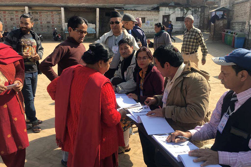 Voters stand in queue to cast their ballot in the second phase of provincial and parliamentary elections in Pashupati Mitra High School, Chabahil, Kathmandu Constituency-4, on Thursday, December 7, 2017. Photo: Rajesh Gurung