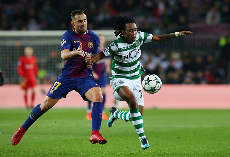 Barcelonau2019s Paco Alcacer in action with Sportingu2019s Gelson Martins during the Champions League match between FC Barcelona and Sporting CP, at Camp Nou, in Barcelona, Spain, on December 5, 2017. Photo: Reuters