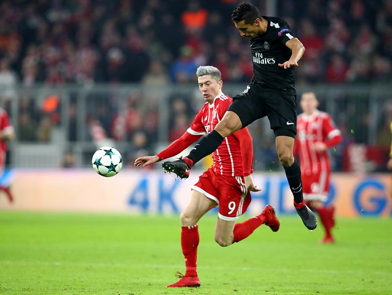 Paris Saint-Germainu2019s Marquinhos in action with Bayern Munich's Robert Lewandowski during the Champions League match between Bayern Munich and Paris St Germain, at Allianz Arena, in Munich, Germany, December 5, 2017. Photo: Reuters