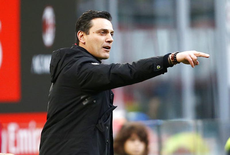 FILE - In this Nov. 26, 2017 file photo, AC Milan coach Vincenzo Montella gives instructions to his players during the Serie A soccer match between AC Milan and Torino at the San Siro stadium in Milan, Italy. Sevilla is hiring Vincenzo Montella as coach, a month after the Italian was fired by AC Milan. (AP Photo/Antonio Calanni, file)
