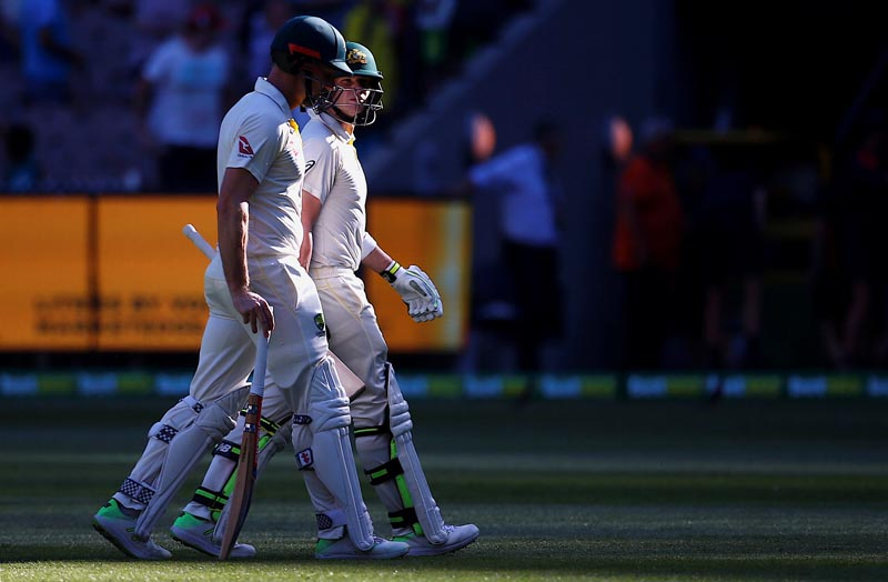 Ashes test match - Australia v England - MCG, Melbourne, Australia, December 26, 2017. Australia's captain Steve Smith walks off the ground with team mate Shaun Marsh at the end of the first day of the fourth Ashes cricket test match. Photo: Reuters