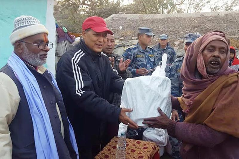 Warm clothes being distributed to locals of a Dalit settlement in Gaur, Rautahat, on Thursday, December 28, 2017. Photo: THT