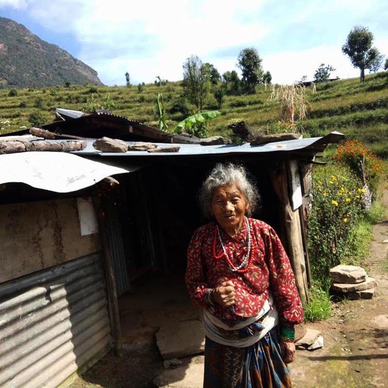 A quake victim standing outside her temporary shelter in Kalinchowk, Dolakha, on Friday, December 22, 2017. Photo: THT