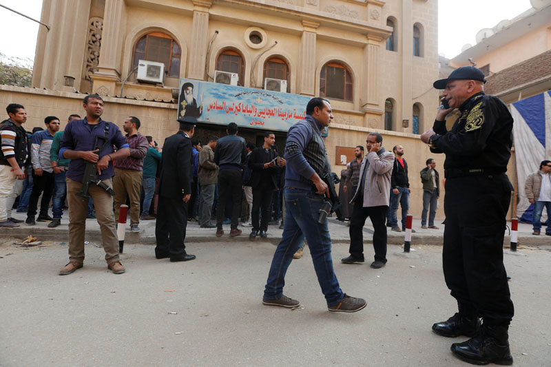 Security forces and people gather at the site of attack on a church in the Helwan district south of Cairo, Egypt December 29, 2017. Photo: Reuters
