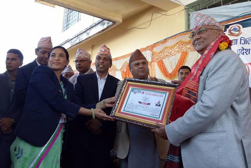 CPN-UML Chair KP Sharma Oli receiving certificate from Election Officer Shakuntala Karki after he won parliamentary polls from Jhapa-5, in Bhadrapur, on Monday.