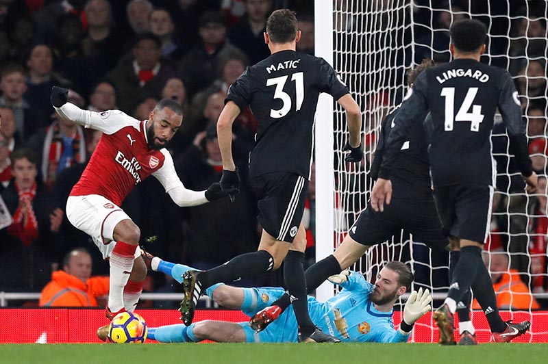 Arsenal's Alexandre Lacazette and Manchester United's goalkeeper David de Gea in action during Premier League match between Arsenal and Manchester United , at Emirates Stadium, in London, Britain, December2, 2017. Photo: Reuters