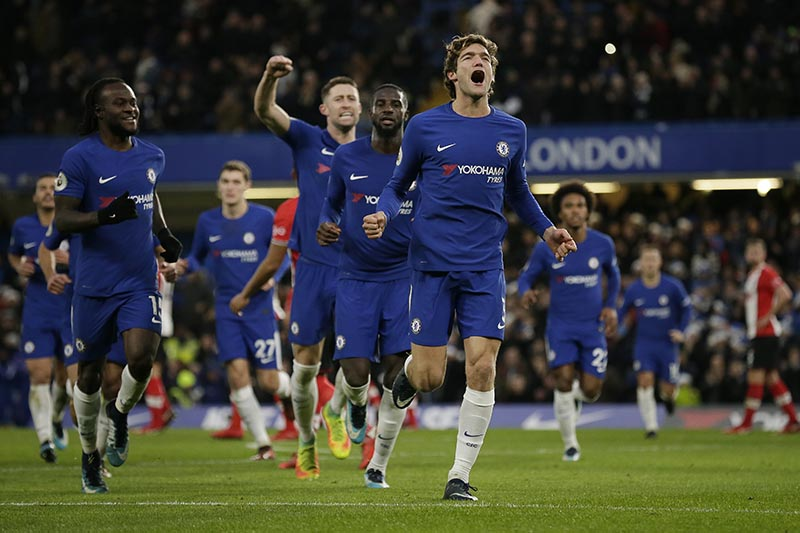 Chelsea's Marcos Alonso (right), celebrates after scoring a free kick during the English Premier League soccer match between Chelsea and Southampton at Stamford Bridge in London, on Saturday December 16, 2017. Photo: AP