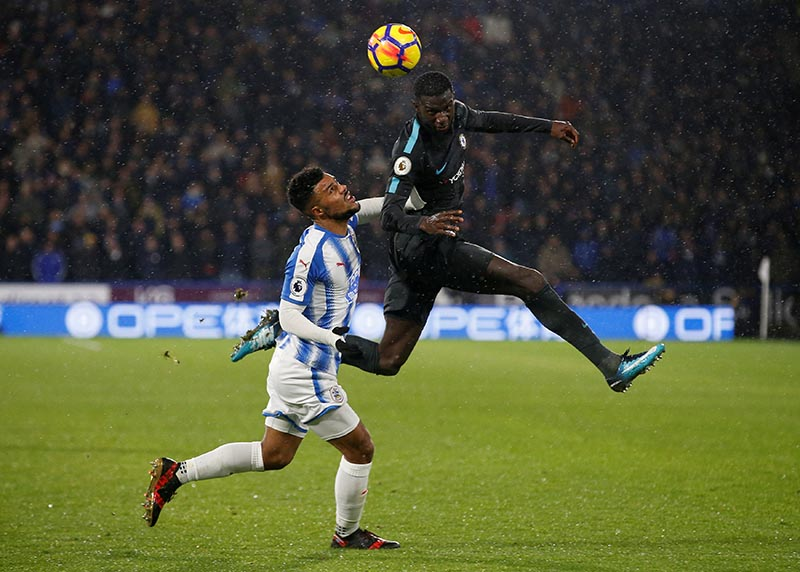 Chelsea's Tiemoue Bakayoko in action with Huddersfield Townu2019s Elias Kachunga during the Premier League match between Huddersfield Town and Chelsea, at John Smith's Stadium , Huddersfield Britain, on December 12, 2017. Photo: Reuters