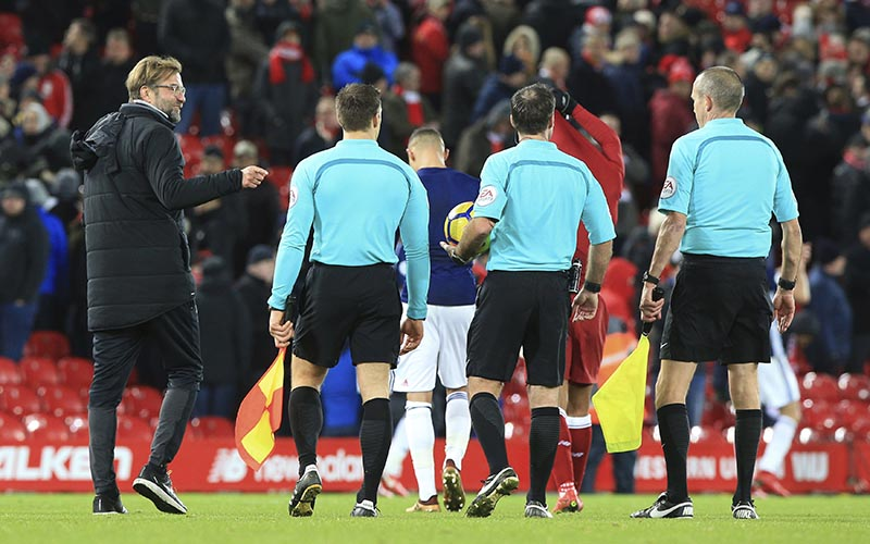 Liverpool manager Jurgen Klopp (left), speaks to Referee Paul Tierney (2nd right), after he disallowed a goal late on during the game against West Bromwich Albion, during their English Premier League soccer match at Anfield in Liverpool, England, on Wednesday December 13, 2017. Photo: Peter Byrne/PA via AP
