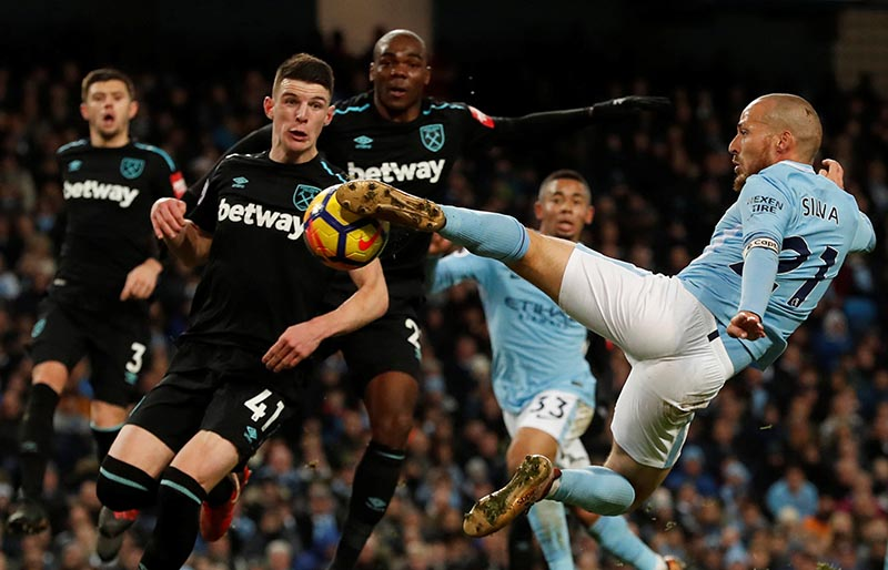 Manchester City's David Silva scores their second goal during the Premier League match between Manchester City and West Ham United, at Etihad Stadium, in Manchester, Britain, on December 3, 2017. Photo: Reuters