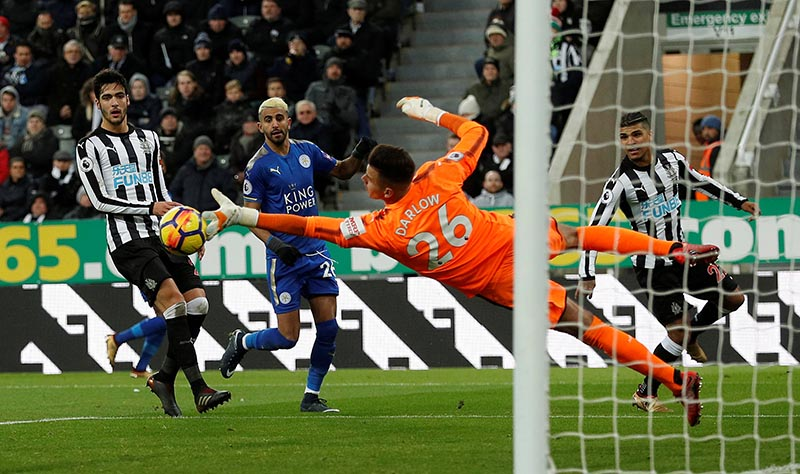 Newcastle United's Karl Darlow saves a shot as Leicester City's Riyad Mahrez looks on during the Premier League match between Newcastle United and Leicester City, at St James' Park, in Newcastle, Britain, on December 9, 2017. Photo: Action Images via Reuters
