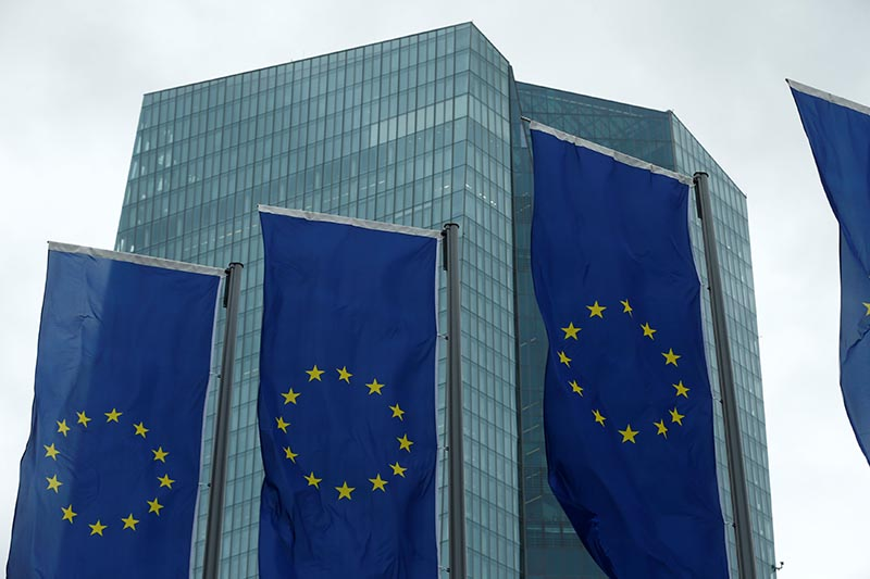 European Union flags flutter outside the European Central Bank (ECB) headquarters in Frankfurt, Germany, on December 14, 2017. Photo: Reuters