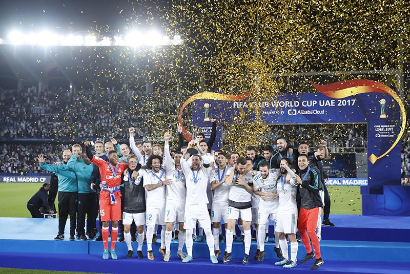 Real Madrid's Sergio Ramos holds the trophy after winning the Club World Cup final soccer match between Real Madrid and Gremio at Zayed Sports City stadium in Abu Dhabi, United Arab Emirates, on Saturday, December 16, 2017. Photo: AP