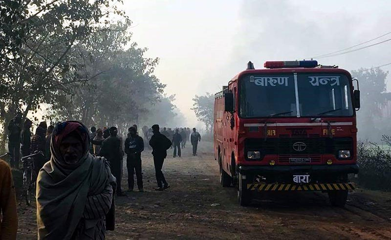 Fire engine parked about a kilometre away from the incident site after it failed to reach Super Gas Industry in Patel Nagar of Birgunj Sub Metropolitan City-24, Parsa district, on Wednesday, December 20, 2017. Photo: Ram Sarraf